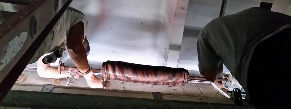 garage door springs replacement in action